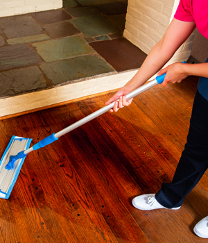 Woman mopping floors