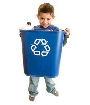 little boy carrying blue recycle bin
