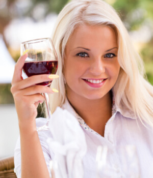 Woman smiling with wine glass