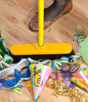 yellow broom sweeping party favors and confetti