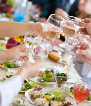 Group of people with wine glasses at dinner table