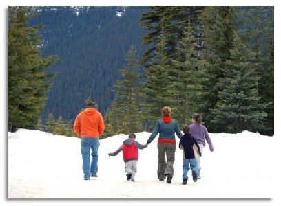 Family Hiking On A Snowy Mountain