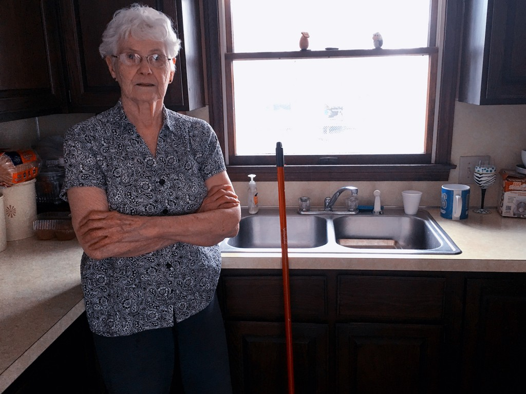 Grandmotherly figure standing in the kitchen