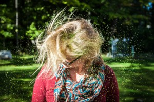 Woman shaking her hair free of glitter