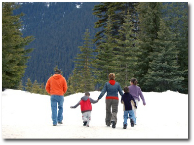 family-hiking-snow