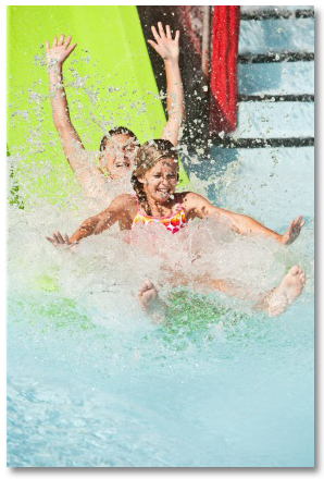 two children going down water slide at water park