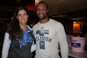 Woman standing next to Detroit Lions Safety Glover Quin