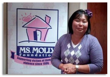danessa of ms molly in front of the ms molly foundation sign